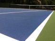 Resurfacing a Tennis Court with The Surface Masters