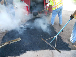 Recycled Asphalt being raked