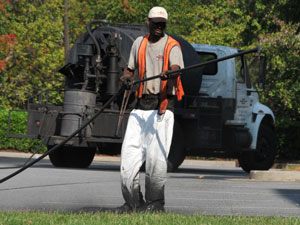 A Contractor's Letter to Customers Regarding Refined Coal Tar Sealers